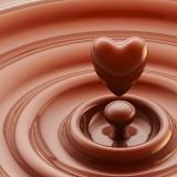 12449333 - chocolate heart as a liquid drop background